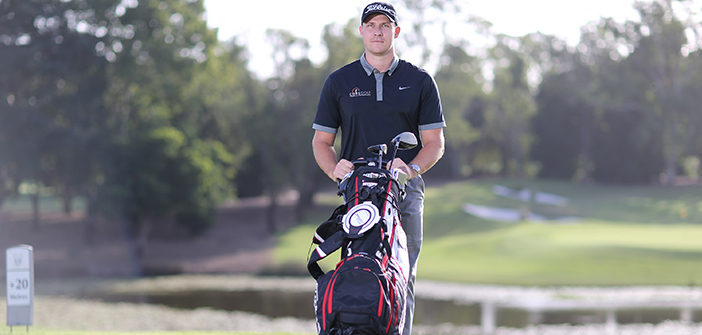 golfer-walks -with-golf-bag